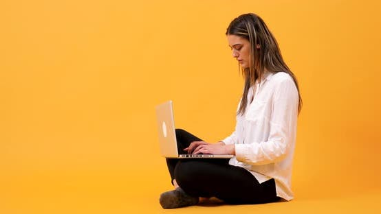 Thumbnail for Student Sitting on an Yellow Background