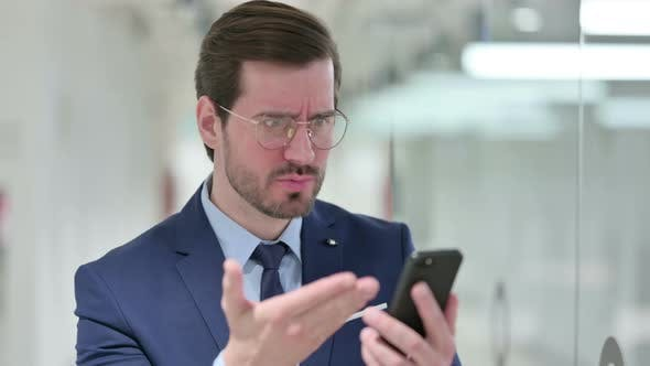 Thumbnail for Portrait of Upset Young Businessman Having Loss on Smartphone