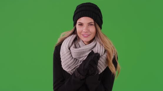 Thumbnail for Attractive millennial girl wearing beanie, scarf, and gloves on green screen