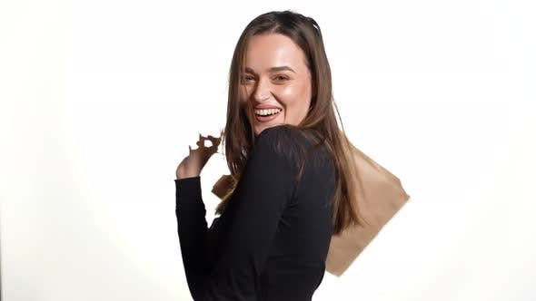 Cover Image for Young Woman Holding a Shopping Bag