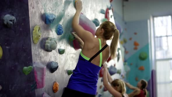 Thumbnail for Three Women Bouldering on Indoor Climbing Wall