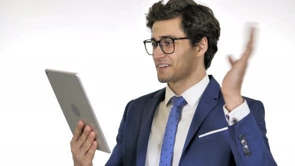 Thumbnail for Online Video Chat on Tablet by Young Businessman, White Background
