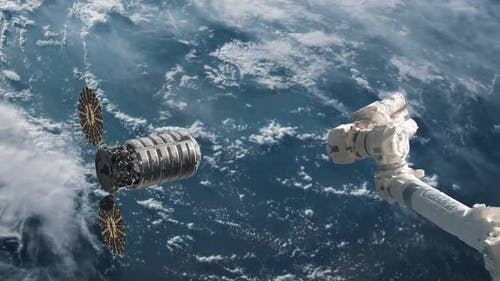 Supply Ship Preparing to Dock with Space Station Over the Surface of Earth