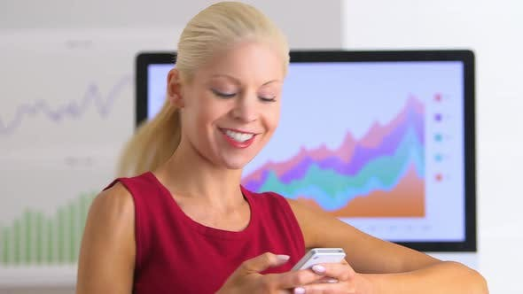 Thumbnail for Business woman texting on smartphone