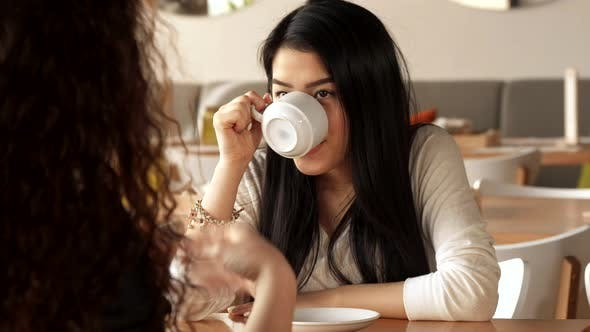 Thumbnail for Girl Laughs About What Her Friend Telling at the Cafe
