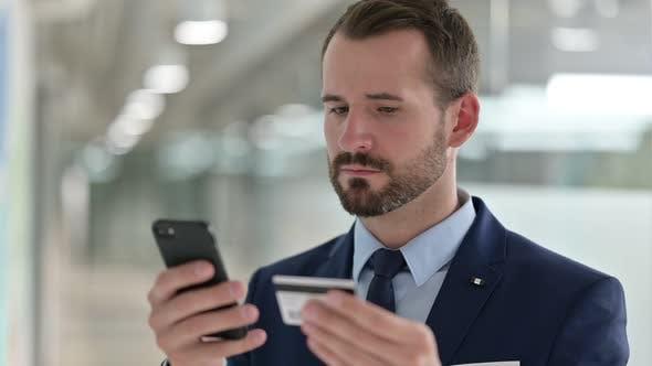 Thumbnail for Portrait of Businessman Having Online Payment Failure on Smartphone