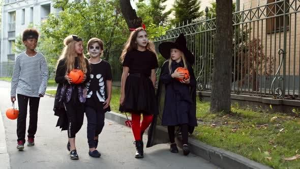 Thumbnail for Five Kids Going along Street on Halloween