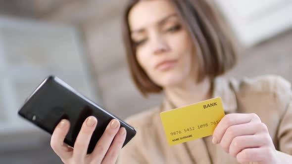 Thumbnail for Woman Using Smartphone for Online Payment with Credit Card