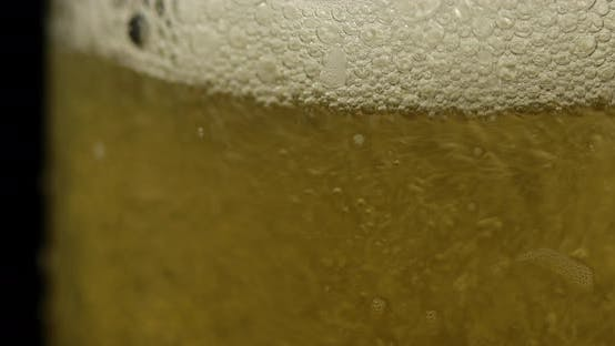 Thumbnail for Pouring Cold Golden Light Beer Into a Glass. Craft Beer Making Bubbles and Foam