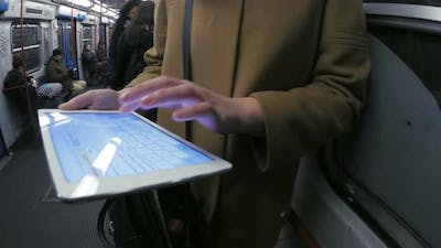 Entertainment with pad during routine subway travel