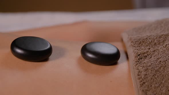 Thumbnail for Back of Woman Having Hot Stone Massage at Spa