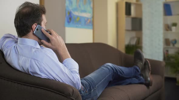 Thumbnail for Man Talking on Smartphone, Discussing Work Moments With His Boss, Communication
