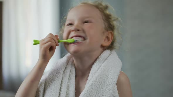 Little Girl Brushing Her Teeth Diligently, Dental Hygiene, Morning Ritual