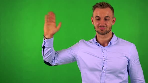 Thumbnail for Young Handsome Business Man Waves with Hand - Green Screen - Studio