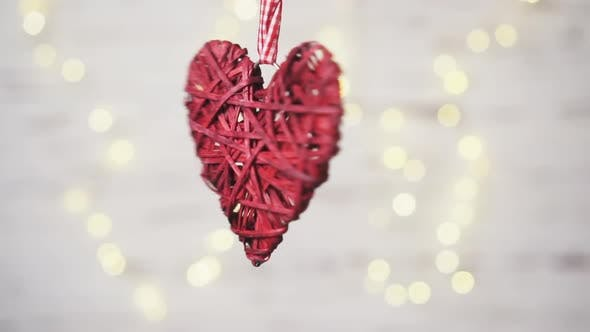Thumbnail for Red Wicker Heart Rotates on a White Background with Warm Bokeh.