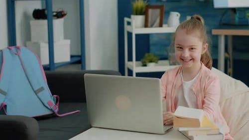 Portrait of Schoolgirl Using Laptop for Online School Classes