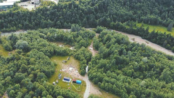 Thumbnail for Aerial View Small Gas Production Site Located in a Mountainous Area Around a Flowing Mountain River