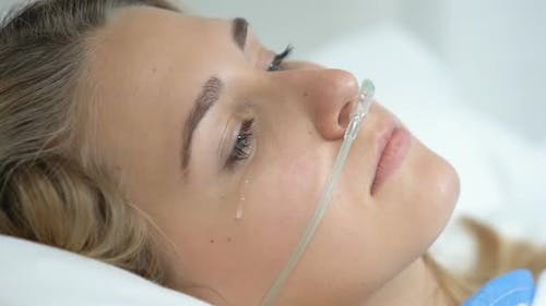 Depressed Female Patient With Nasal Cannula Looking Camera, Sickness Disability