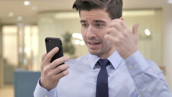 Thumbnail for Businessman Excited for Success on Smartphone