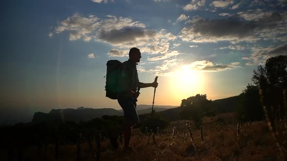 Thumbnail for Young Male Traveler Climbing Mountain During Sunset on Autumn Evening Spbd.