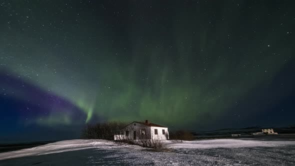 Thumbnail for Northern Lights Over the Cottage. Winter Landscape, Iceland. Timelapse
