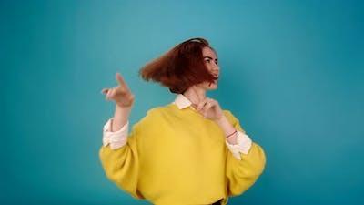Model in Trendy Yellow Sweater Dances