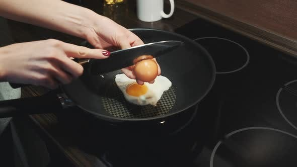 Thumbnail for Female Hands Breaking Eggs with Knife and Frying on Pan