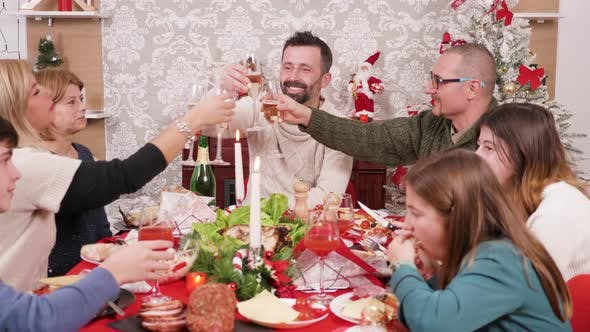 Thumbnail for Beautiful Big Family Clinking Glasses of Champagne