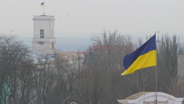 Thumbnail for Flag of Ukraine flutters upon annex Crimea. Occupied Crimea territory. Russian invasion of Crimea.