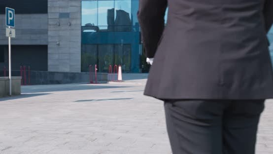 Thumbnail for Middle Aged Man in Suit Riding Electric Scooter in City, Tracking Shot