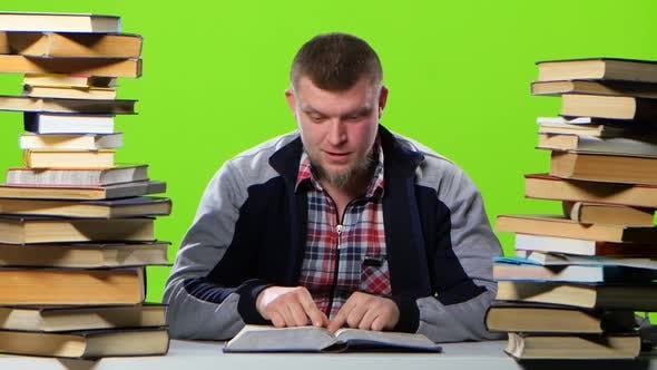 Thumbnail for Guy That's Fun Reading and Leafing Through the Book. Green Screen