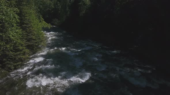 Thumbnail for Aerial Drone Traveling Along Water Rapids Between Evergreen Forest 1