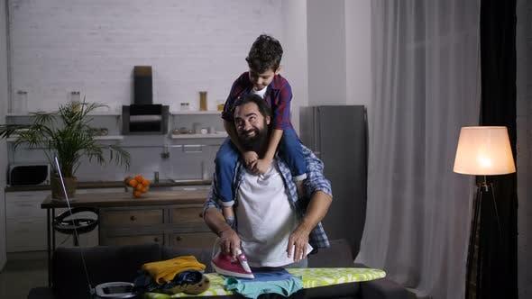 Joyful Family Doing Household Chores Together