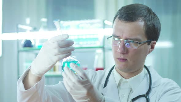 Doctor With Tube In Laboratory