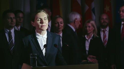 Female Politician behind Tribune