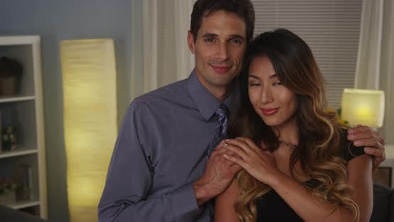 Thumbnail for Interracial couple smiling at camera
