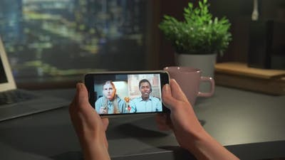 Video Meeting with Multiracial Team on Smartphone