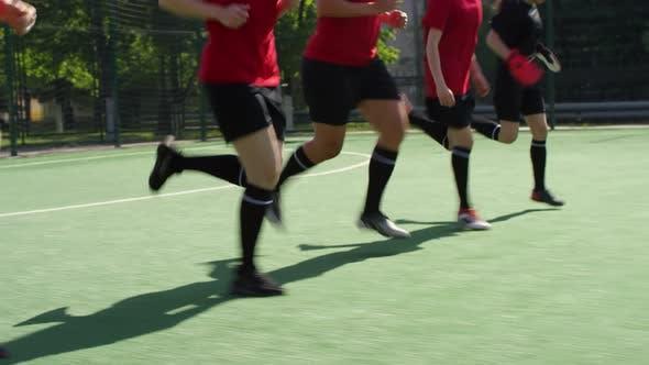 Female Soccer Athletes Doing Heel Lift Running