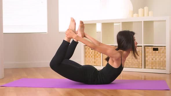 Thumbnail for Chinese woman doing yoga: Bow