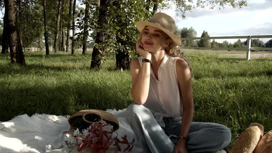 Young Girl On A Picnic Enjoys The Rest