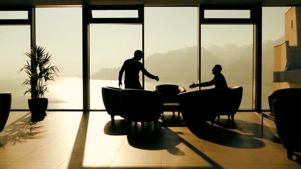 Thumbnail for Two Young Business People Having a Meeting in Modern Lobby Hall Chatting Together