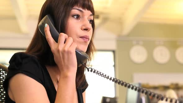 Thumbnail for Business female answering phone call in office