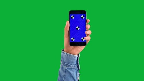 Mixed Race Deep Skin Tone Male Hand with Smartphone with Blue Screen with Tracking Markers on