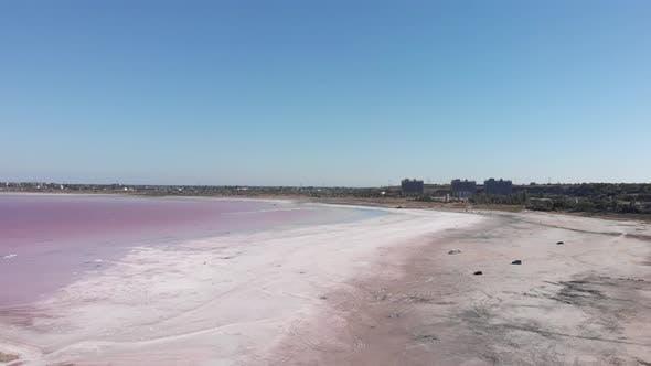 Thumbnail for Drying salty estuary Kuyalnik in Ukraine, water is colored with green alga Dunaliella salina.