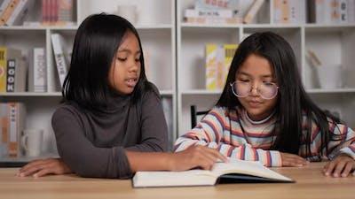 Girl short hair teaching book with friend