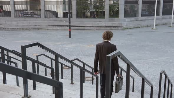 Thumbnail for Businessman Goes Down the Stairs