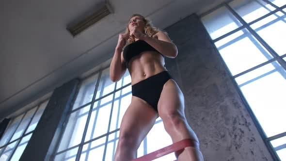 Thumbnail for Athlete Female Making Squats Using Elastic Band