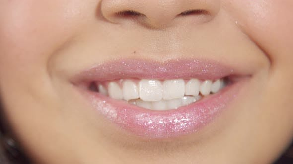 Thumbnail for Closeup of Womans Lips with Shiny Lipgloss Smiling