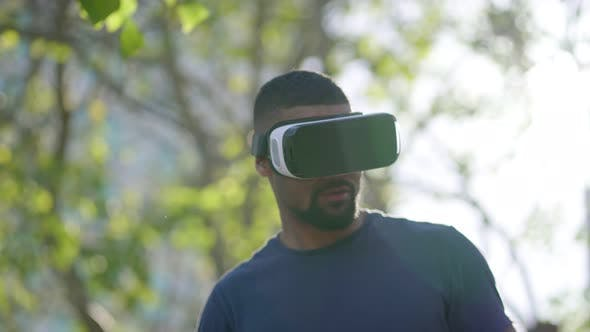 Thumbnail for Man in Virtual Reality Glasses Managing New Reality with Hands