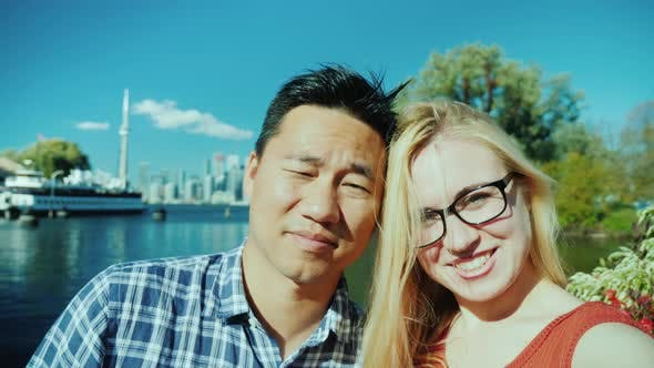 Thumbnail for Happy Couple Doing Selfie on the Background of Toronto